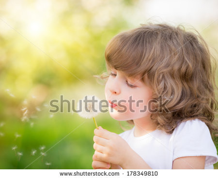 stock-photo-happy-child-blowing-dandelion-outdoors-in-spring-park-178349810